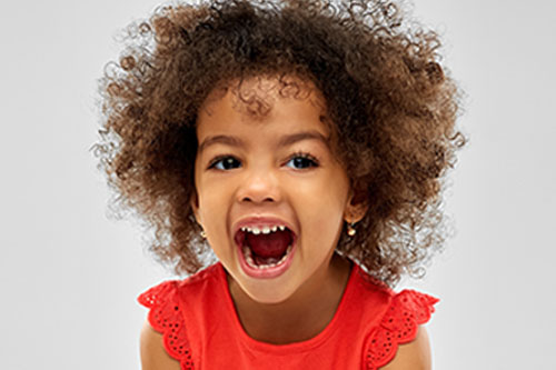 happy laughing little african american girl at a Preschool & Daycare Serving New Braunfels, TX