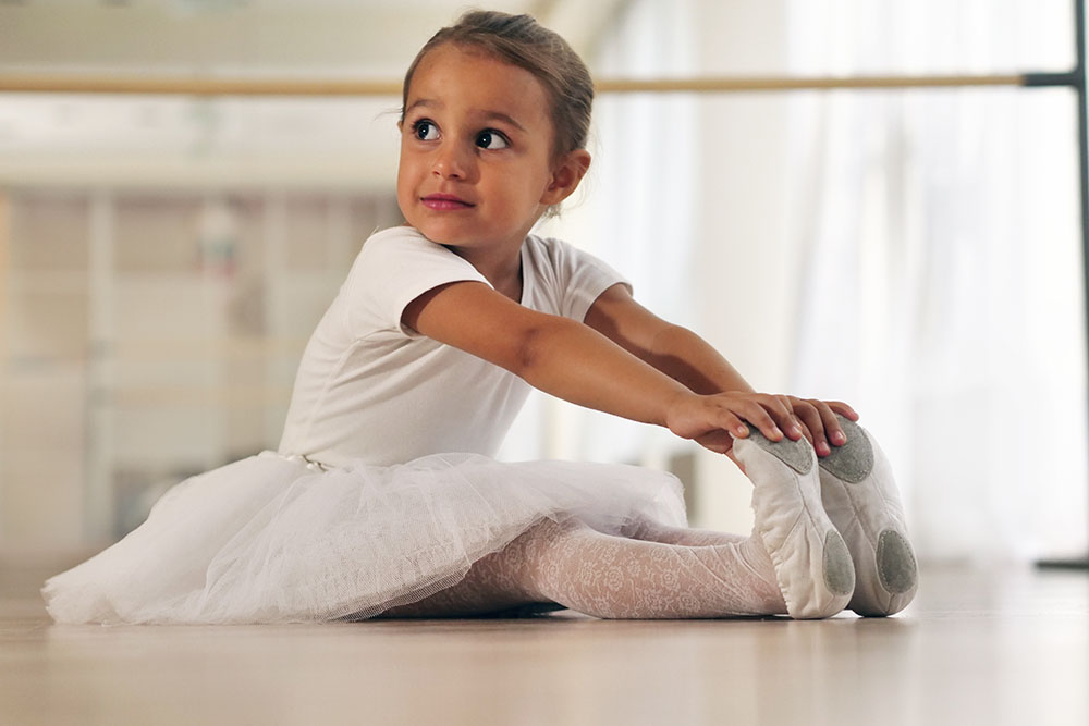 young smiling girl doing ballet at a Preschool & Daycare Serving New Braunfels, TX