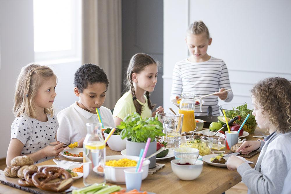 Children enjoying a healthy meal at a Preschool & Daycare Serving New Braunfels, TX