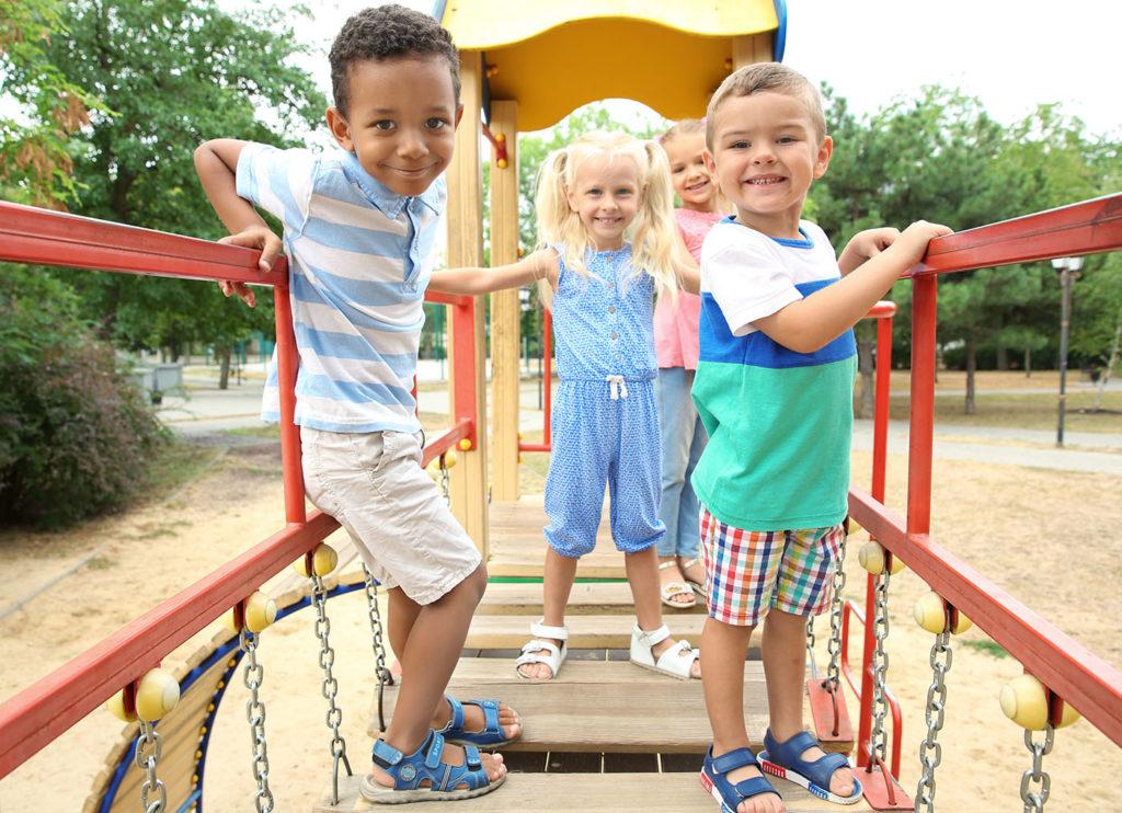 Cute children on playground at a Preschool & Daycare Serving New Braunfels, TX