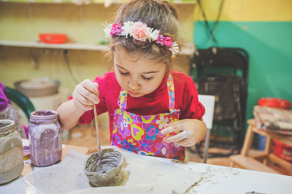 Girl At Pottery Workshop at a Preschool & Daycare Serving New Braunfels, TX