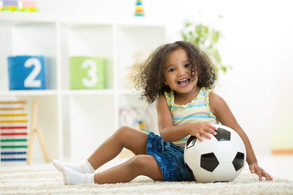 Kid girl playing soccer at a Preschool & Daycare Serving New Braunfels, TX