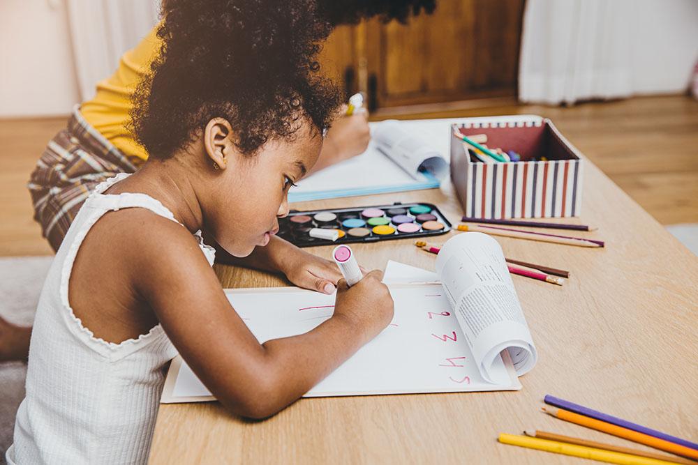 kids doing homework at a Preschool & Daycare Serving New Braunfels, TX